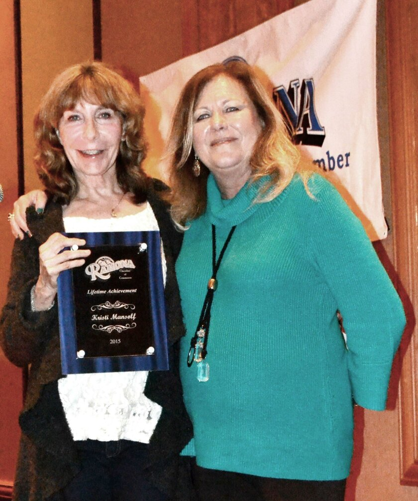 Carol Fowler, right, awards the Lifetime Achievement Award to Kristi Mansolf, who has served the community in various capacities for many years.