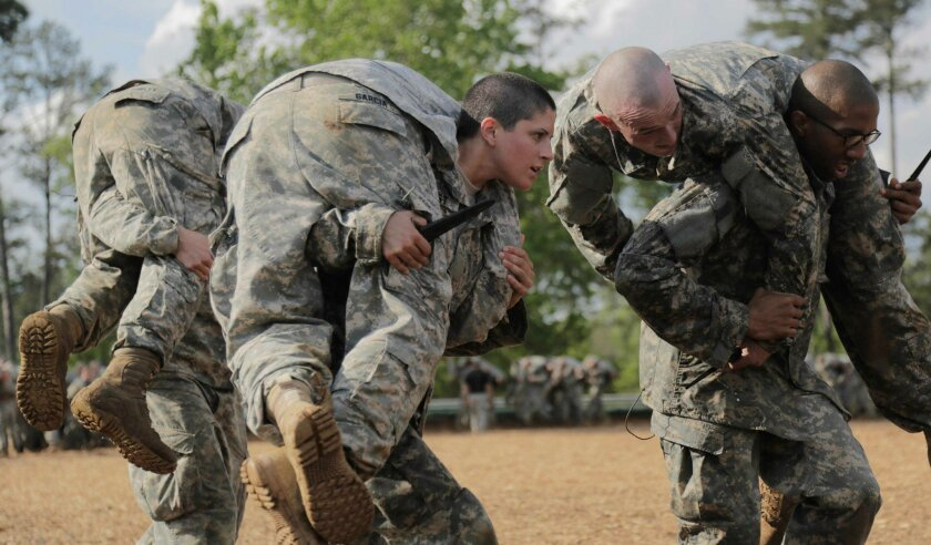Capt. Kristen Griest, center, participates in combat training during the Ranger Course at Ft. Benning, Ga., April 20, 2015. Griest is one of the first two women to graduate from the course. Defense Secretary Ashton Carter on Dec. 3, 2015, announced that the Pentagon will open all combat roles in th