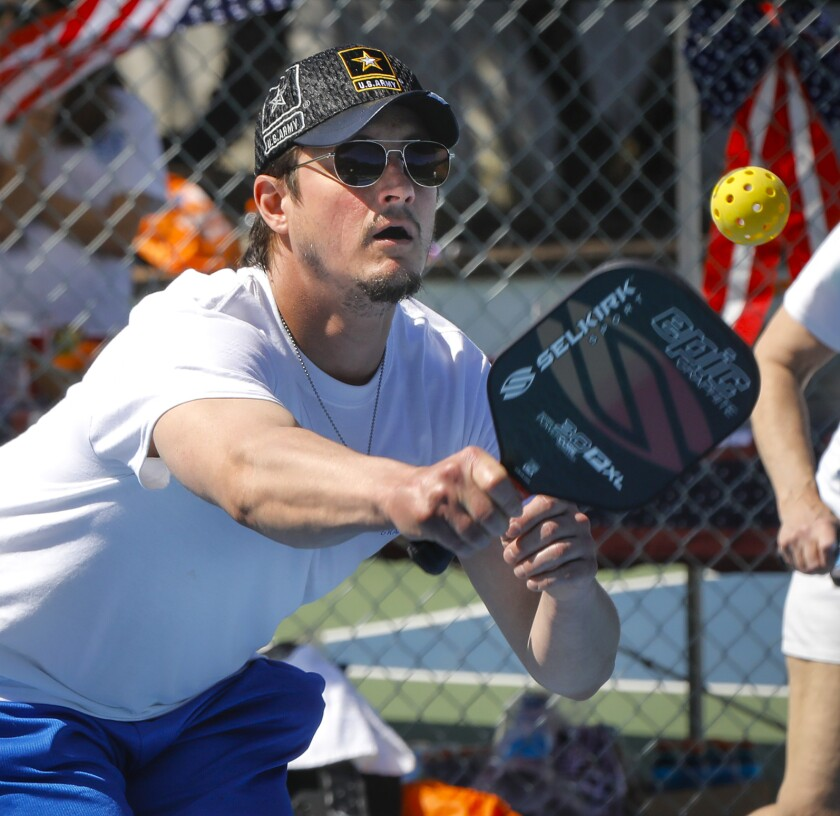Jonny Tomcek, a former Army specialist 4, who has post-traumatic stress disorder, was one of the former and current military service members to participate in the Wounded Warrior Project Pickleball Fest at the San Diego Tennis & Racquet Club.