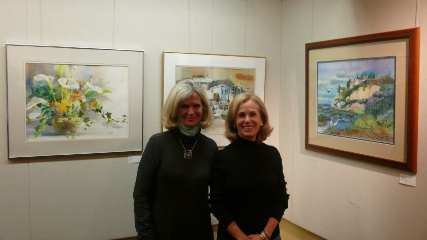 Arlene Powers and Patricia Jasper Clark of the library art committee