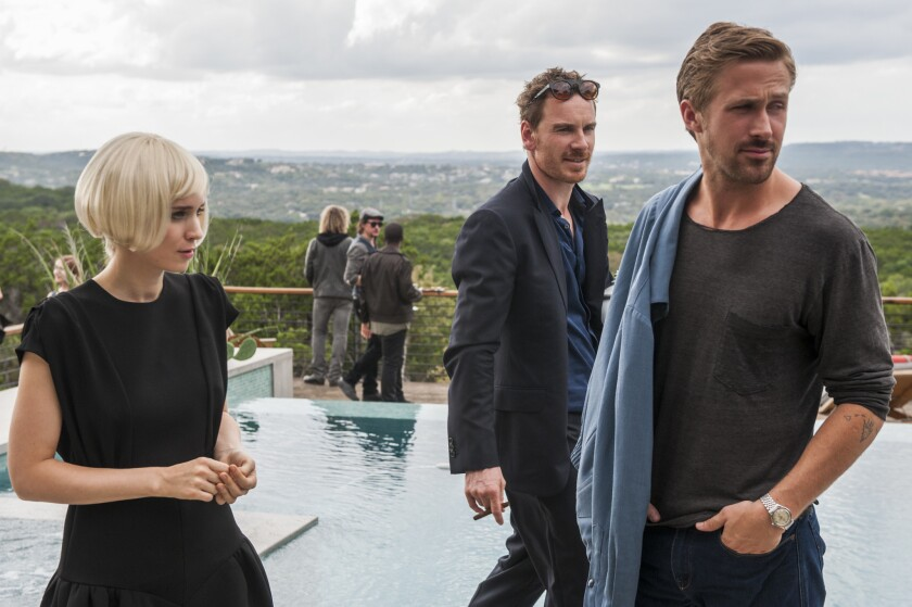 "Rooney Mara, left, Michael Fassbender, and Ryan Gosling star in Terrence Malick's ""Song to Song."""