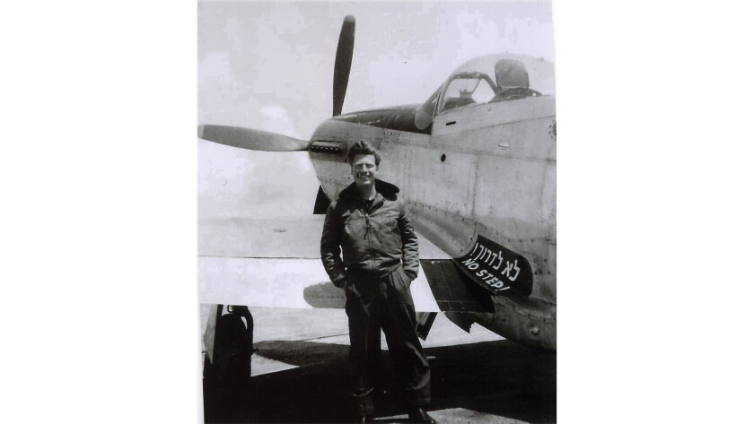 Commander Mitchell Flint stands next to an American P-51 Mustang in Israel in 1949.