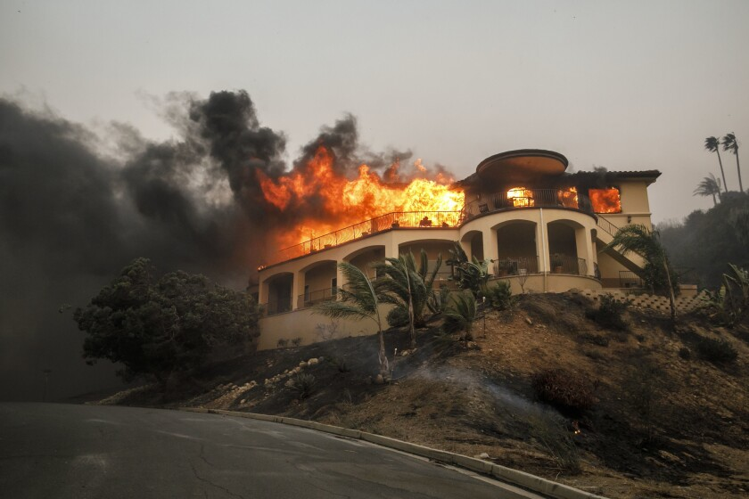 A house burns on Island View Drive in the central Ventura foothills during the Thomas fire in December.
