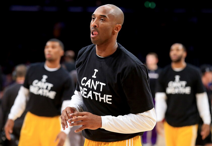 "LOS ANGELES, CALIF. - DEC. 9, 2014. Kobe Bryant and other lakers wear ""I Can't Breathe"" T-shirts while warming up for the game against the Kings on Tuesday, Dec. 9, 2014, at Staples Center in Los Angeles. (Luis Sinco/Los Angeles Times)"