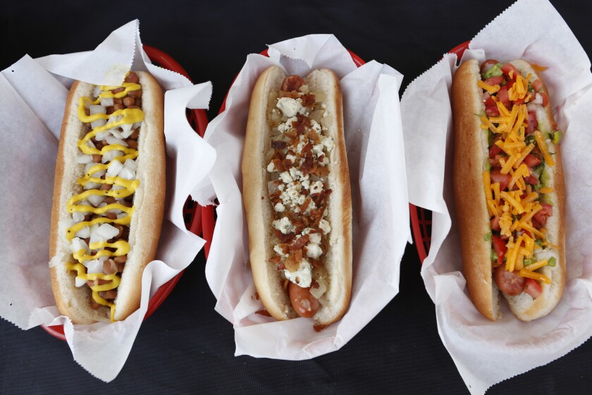 An array of specialty hot dogs from Tail O' the Pup in Los Angeles.