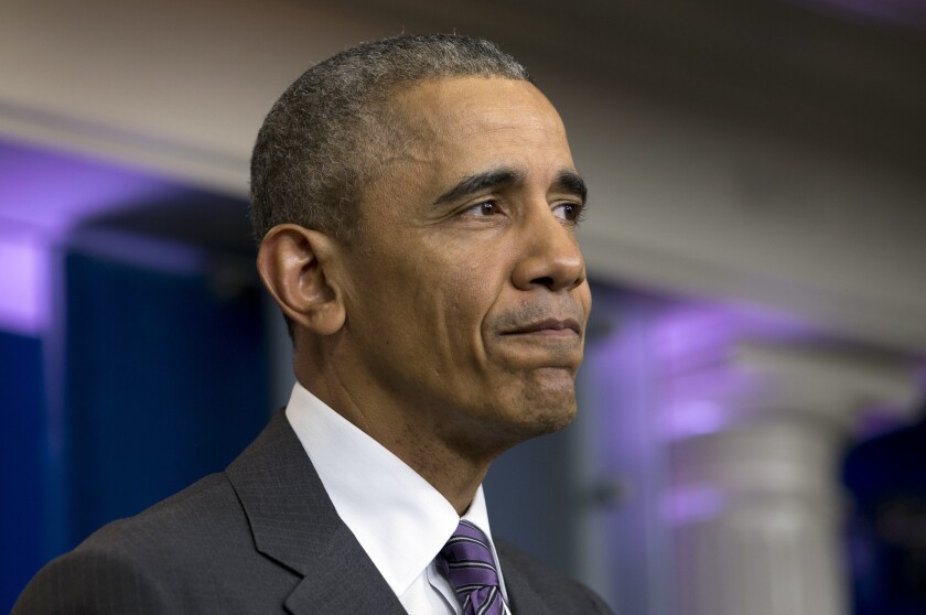President Obama pauses as he speaks during a mock news conference with college students in the White House on April 28.