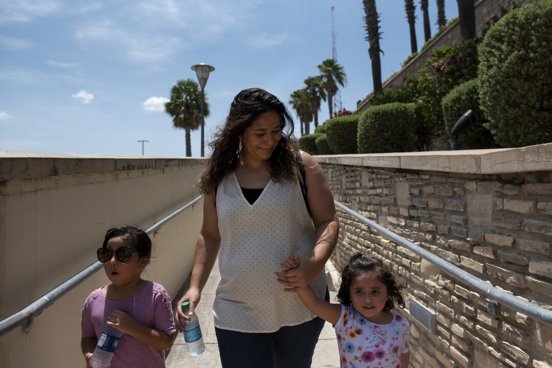Ilse Mendez walks with her daughters Aaliyah, 5, and Aalizah, 3, at the outlet mall in Laredo, Texas.