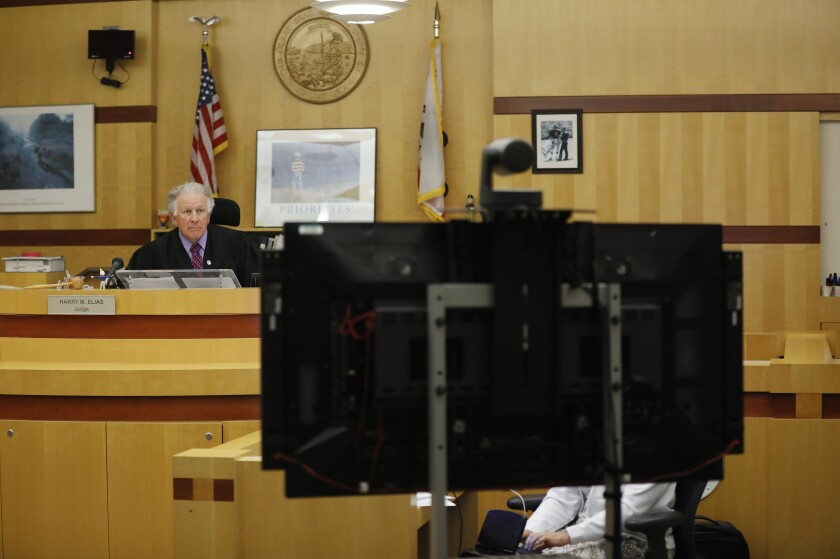 Superior Court Judge Harry Elias listens during a video arraignment at the Vista Courthouse on May 4. With the pandemic leading officials to limit courtroom access, San Diego Superior Court has started livestreaming audio from some criminal hearings on YouTube.