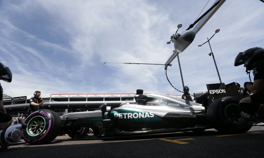 Mercedes driver Lewis Hamilton of Britain parks his car in front of the team garage during the second free practice at the Monaco racetrack in Monaco, Monaco, Thursday, May 26, 2016. The Formula one race will be held on Sunday. (AP Photo/Petr David Josek)