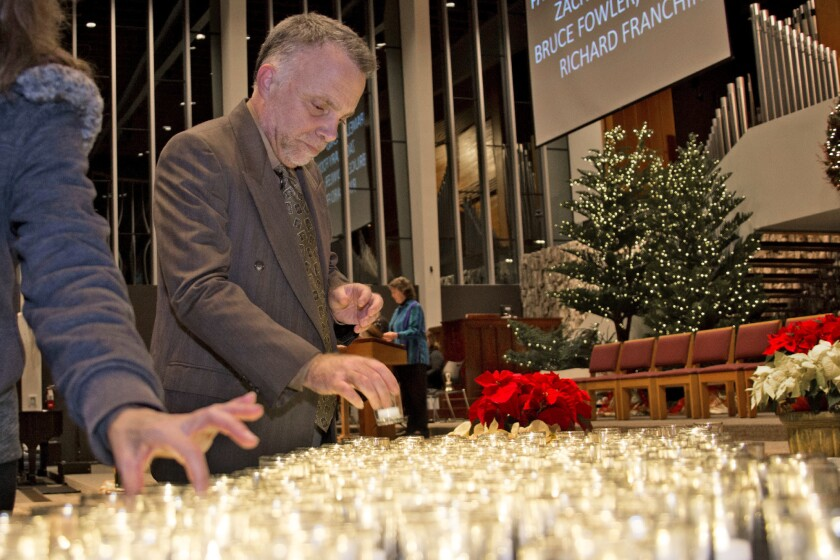 Candles were placed for those who died living on the streets in Orange County this year.