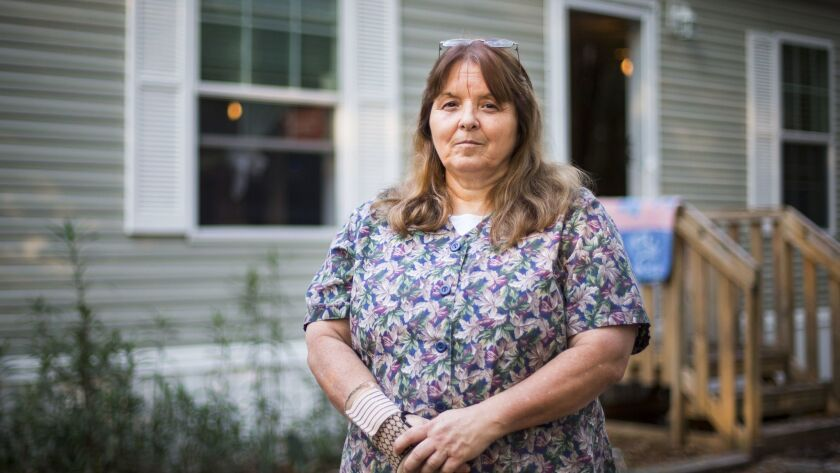 Kathy Watson outside her home in Lake City, Fla. The former business owner, who relies on the Affordable Care Act for health coverage, voted for Trump believing he wouldn't really repeal the healthcare law.