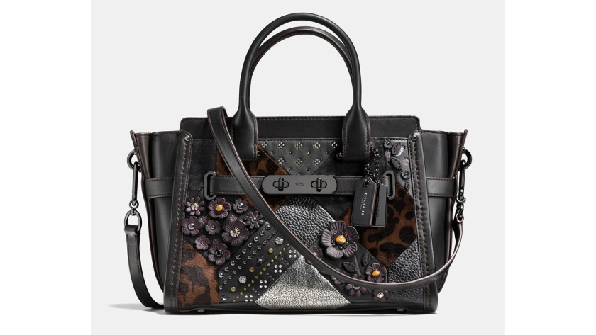 """Americana-inspired quilting appears on the Coach """"Swagger"""" handbag with texture and craft. Rivets are a hat tip to workwear, while signature Coach patterns on printed haircalf are a luxe take on patchwork; $695 at the Grove and Beverly Center and the Rodeo Drive store."""