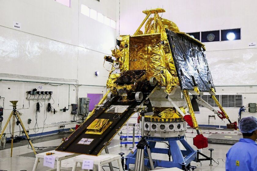 Scientists with the Indian Space Research Organization work on the orbiter vehicle of Chandrayaan-2, India's first moon lander.