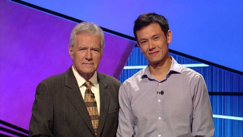 "Alex Trebek with ""Jeopardy!"" contestant Lucas Kwan Peterson in 2012."