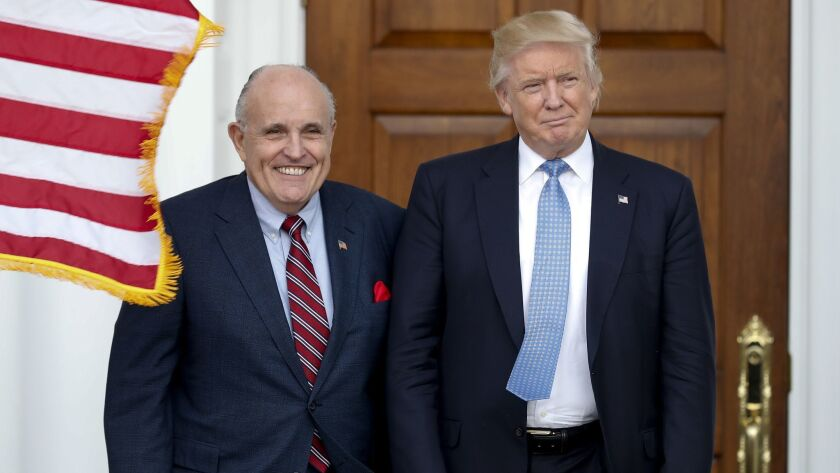 In this Nov. 20, 2016, photo, then-President-elect Trump, right, and former New York Mayor Rudy Giuliani as Giuliani arrives at the Trump National Golf Club Bedminster clubhouse in Bedminster, N.J.