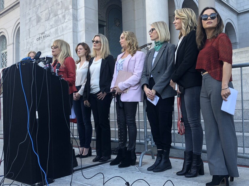 On the morning after Harvey Weinstein's conviction in Manhattan, actress Rosanna Arquette stands with 11 other women who have accused the producer of sexual assault at a press conference at Los Angeles City Hall.
