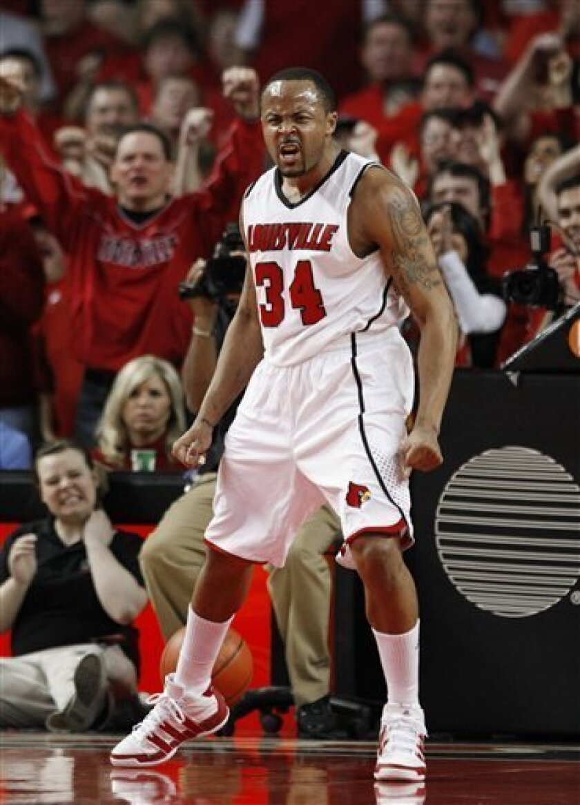 Louisville's Jerry Smith reacts after hitting a three-point shot during the first half of an NCAA college basketball game against Syracuse in Louisville, Ky., Saturday, March 6, 2010. (AP Photo/Ed Reinke)