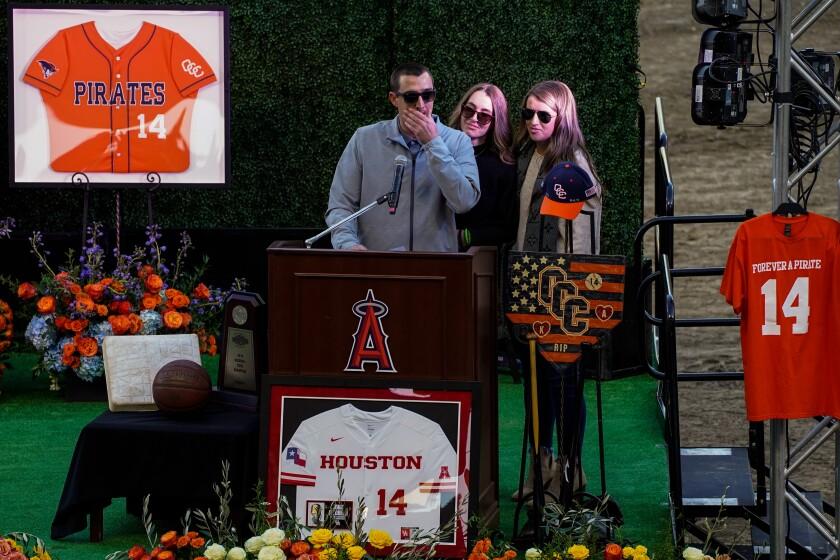 JJ Altobelli, with Lexi Altobelli and Carly Konigsfeld, speaks at Angel Stadium Feb. 10.