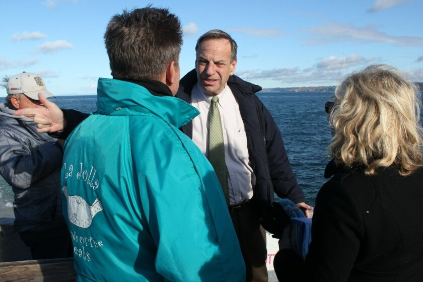 San Diego Mayor Bob Filner spoke with members of the La Jolla Friends of the Seals during a visit to Children's Pool on Saturday. Pat Sherman Photos