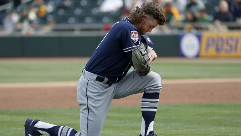 San Diego Padres pitcher Chris Paddack kneels before pitching against the Oakland Athletics during t