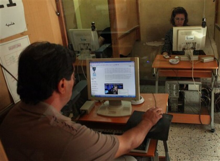 Iraqi people surf the internet for the WikiLeaks web site in Baghdad, Iraq, Saturday, Oct. 23, 2010. Military documents laid bare in the biggest leak of secret information in U.S. history suggest that far more Iraqis died than previously acknowledged during the years of sectarian bloodletting and c