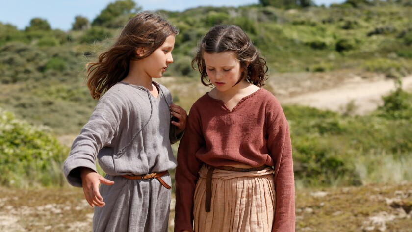 (L-R) - Lise Leplat Prudhomme as young Joan of Arc (Left) discusses the suffering of the French peop