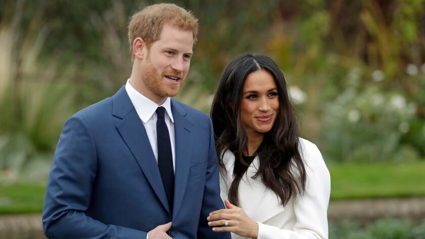 FILE - In this Monday Nov. 27, 2017 file photo, Britain's Prince Harry and his fiancee Meghan Markle