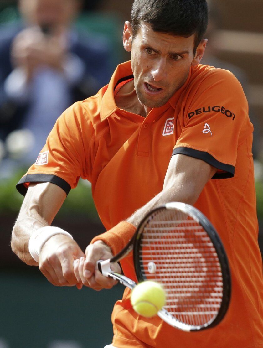 Serbia's Novak Djokovic returns the ball to Luxembourg's Gilles Muller during their second round match of the French Open tennis tournament at the Roland Garros stadium, Thursday May 28, 2015 in Paris. (AP Photo/Thibault Camus)