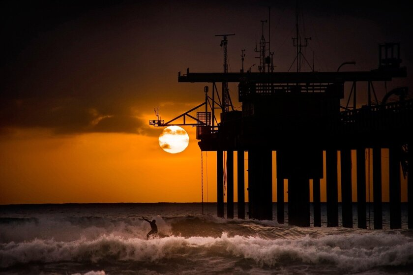 "This photo of the pier by Lev Tsimring, a former oceanographer, is titled ""Surfing Into the Night."" Tsimring's wife works for the Scripps Institution of Oceanography."