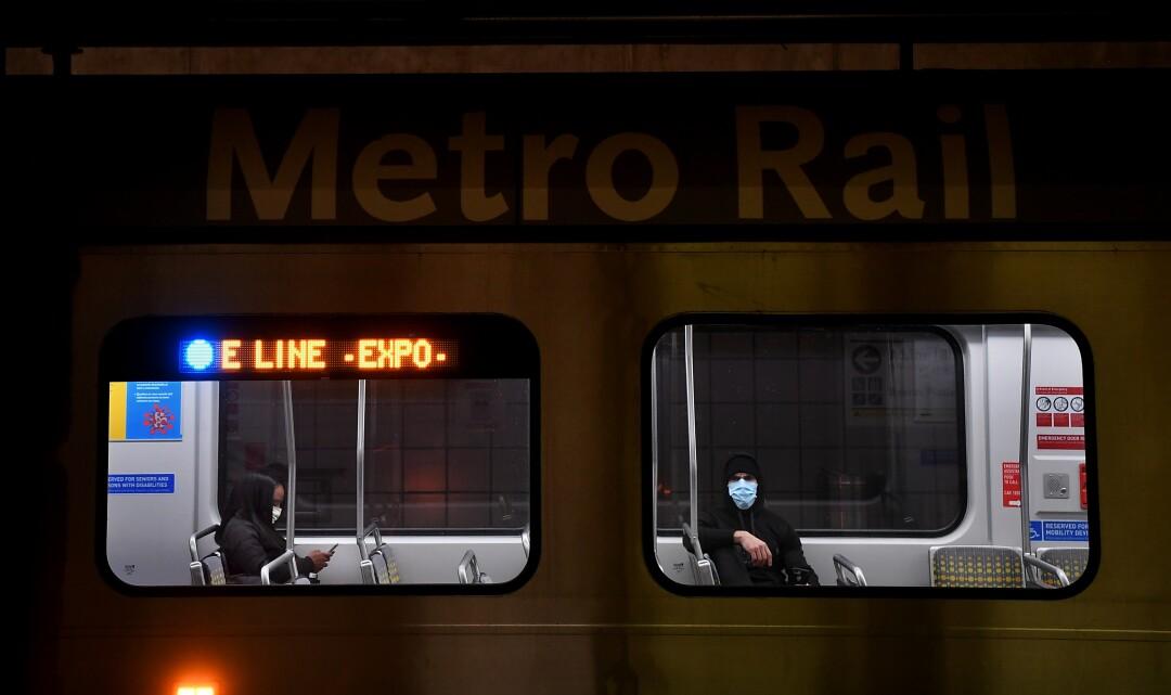 Passengers wear masks on a Metro train in downtown Los Angeles.