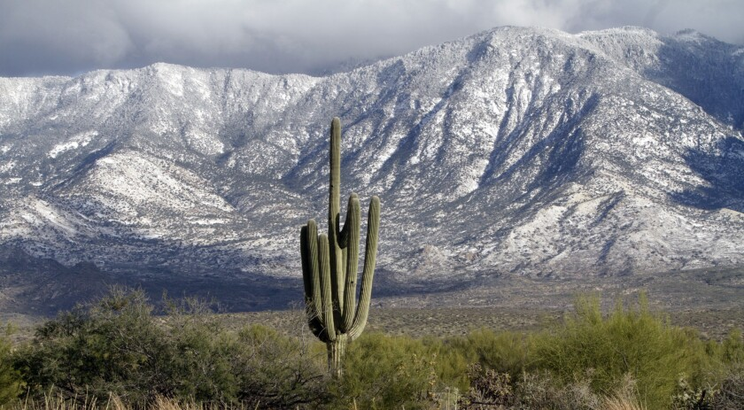 Sunshine hits the Santa Catalina Mountain range north of Tucson, Ariz., on Dec. 30, 2010, after an o