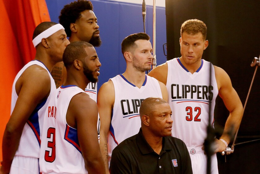 Clippers players (from left) Paul Pierce, Chris Paul, DeAndre Jordan, J.J. Redick and Blake Griffin join Coach Doc Rivers for a photo during media day at the team's training facility in Playa Vista on Friday.
