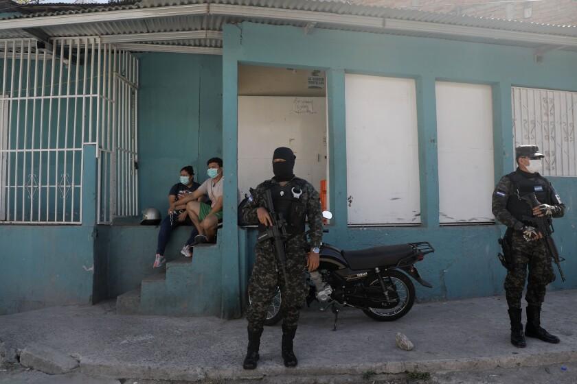 Soldiers enforce a curfew in Tegucigalpa, Honduras.