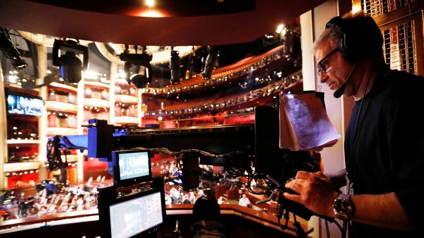 Techno-Jib operator Jay Kulick positions the camera at the end of the boom for a shot during rehearsals in the Dolby Theatre in Hollywood before the 89th Academy Awards ceremony.