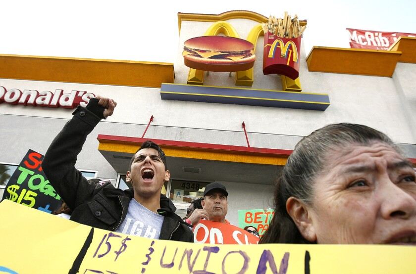 Protesters demanding a $15-an-hour minimum wage demonstrate outside a McDonald's restaurant in Los Angeles last December.