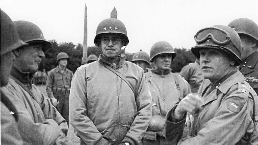 General Omar Bradley attends the funeral of General Theodore Roosevelt, Jr. in Normandy on July 13,