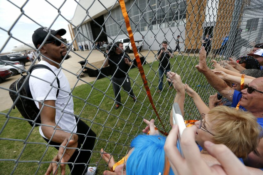 Oklahoma City's Kevin Durant (35) greets fans after the Oklahoma City Thunder arrive home from the NBA Western Conference Finals at Will Rogers Airport in Oklahoma City, Tuesday, May 31, 2016. The Thunder lost to the Golden State Warriors in Game 7 of the series Monday night. (Sarah Phipps/The Okla