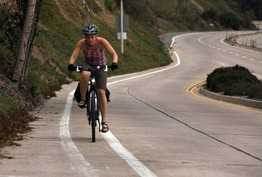 Uphill, downhill, on level ground -- Alison Whitney has spent a year commuting by bicycle