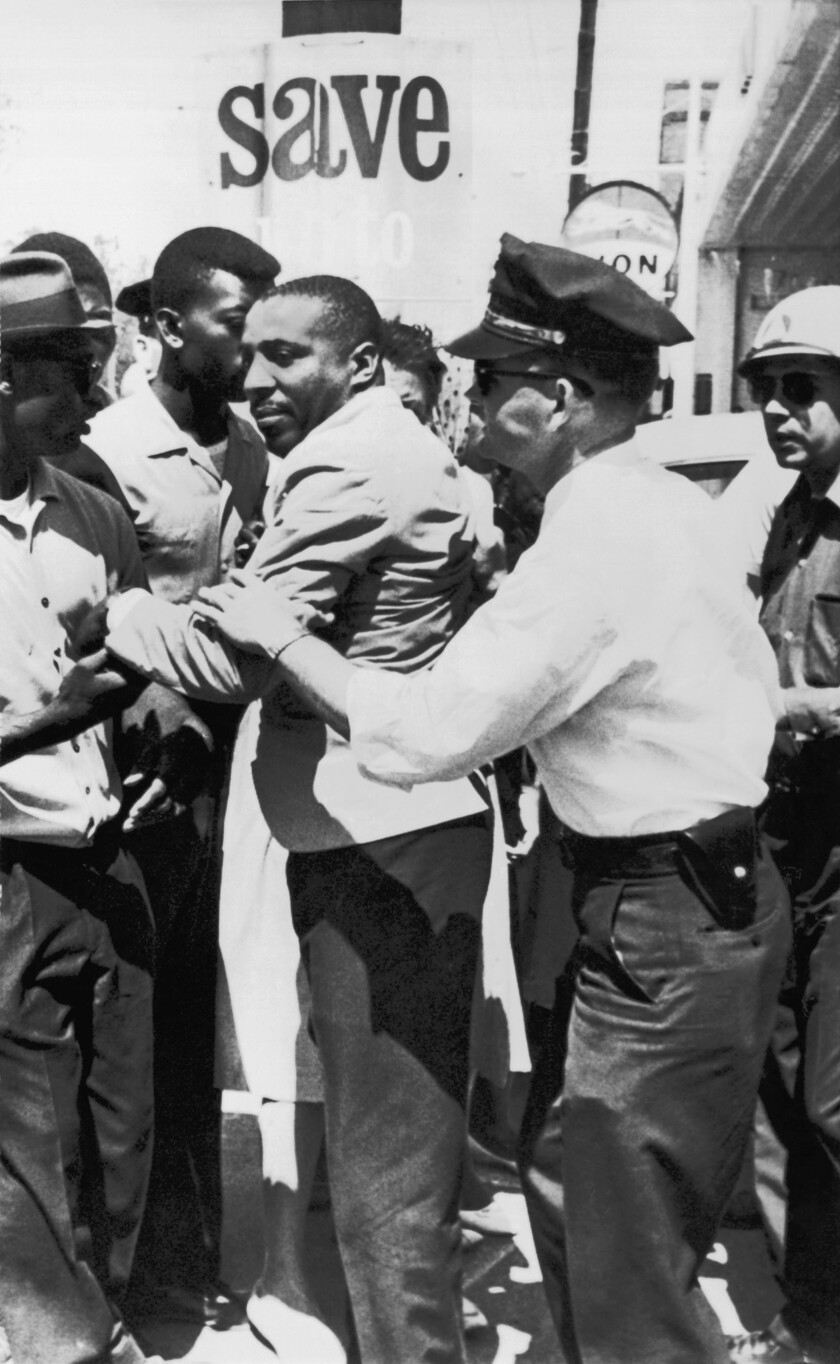 Dick Gregory is accosted by police in Mississippi on April 2, 1963