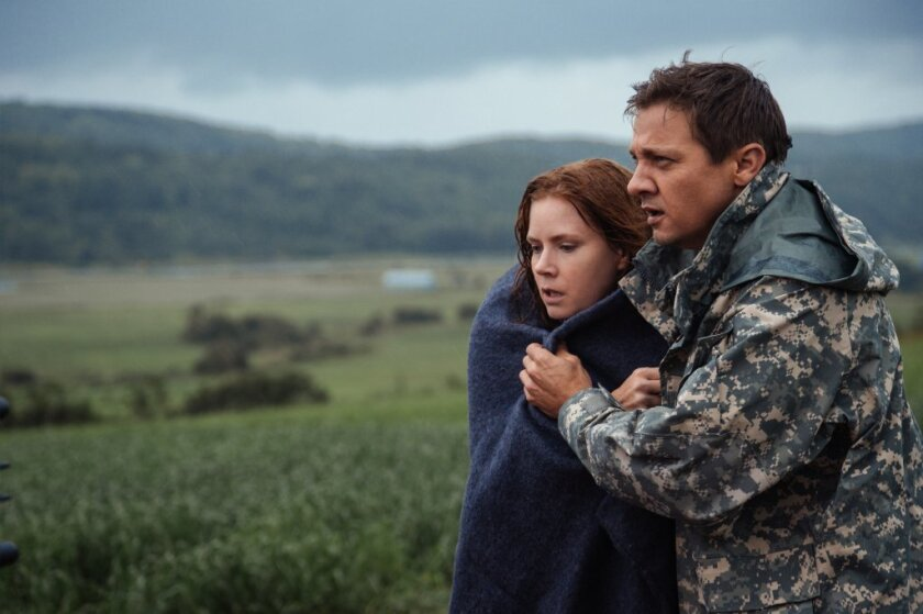 "Amy Adams as Louise Banks and Jeremy Renner as Ian Donnelly in ""Arrival."""