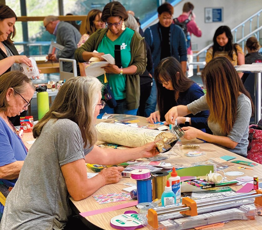 Participants in UC San Diego's Geisel Library celebration of World Bookmark Day, Feb. 25, 2020 create their own bookmarks.