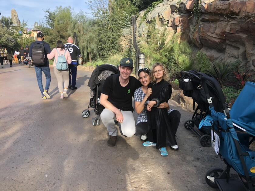 Josh Graves, his wife, Gabrielle Graves, and their 4-year-old son, Will, visit Star Wars: Galaxy's Edge in Disneyland on Thursday.