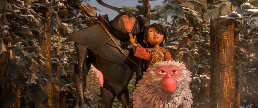 "Beetle, voiced by Matthew McConnaghey, Kubo, voiced by Art Parkinson, and Monkey, voiced by Charlize Theron, in ""Kubo and the Two Strings."""