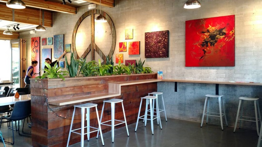 OB Garden Café offers more than just food and drinks— there's also yoga on the roof deck.