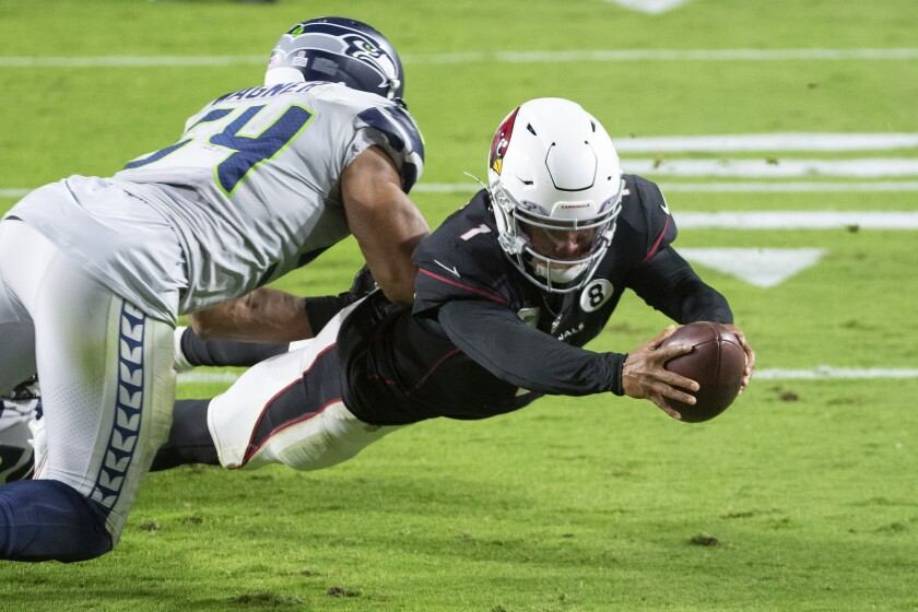 Cardinals quarterback Kyler Murray (1) dives past Seahawks linebacker Bobby Wagner for a touchdown last Sunday.