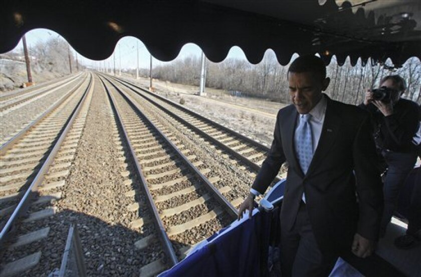 President-elect Barack Obama wallks on his inaugural train en route to Wilmington, Del.., Saturday, Jan. 17, 2009. (AP Photo/Pool, Chang W. Lee)