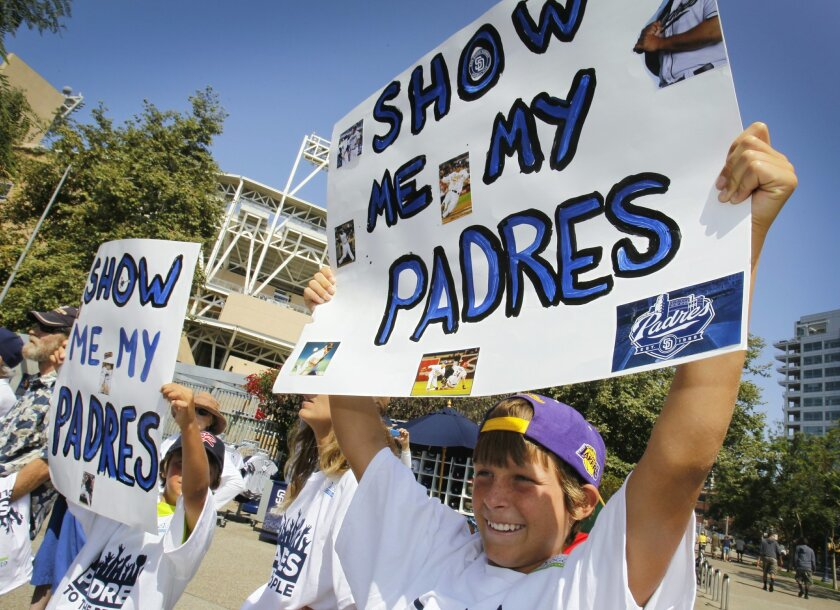 "Stewart Pond, 12, of Scripps Ranch lobbies for an end to stalemated TV talks that have kept many fans from watching televised games this season at the ""Padres To The People"" rally outside Petco Park on Sunday, July 22, 2012."