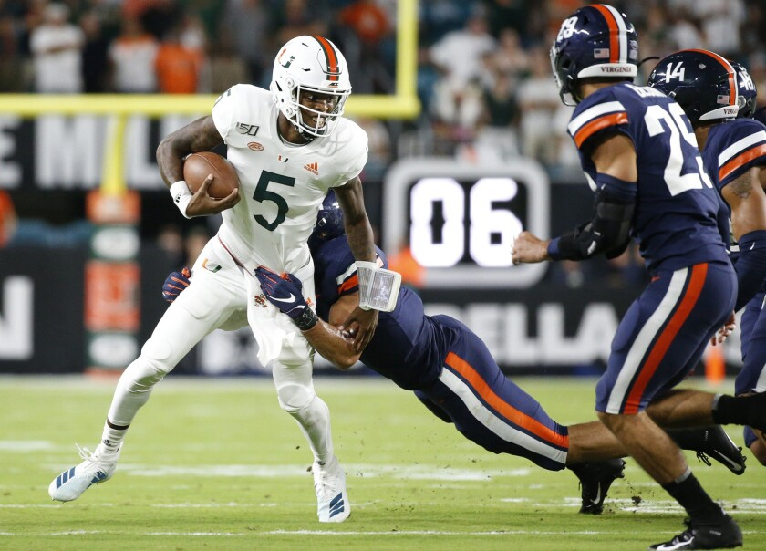 Miami quarterback N'Kosi Perry runs against Virginia in Miami Gardens, Fla., on Friday night.