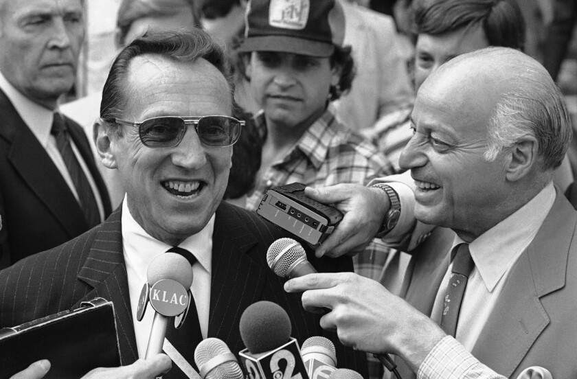 Oakland Raiders owner Al Davis, right, and his attorney Joseph Alioto outside the federal courthouse in Los Angeles, May 7, 1982.
