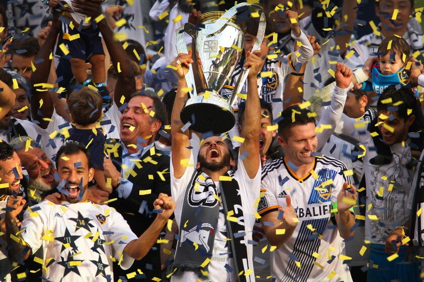 Landon Donovan hoists the MLS Cup trophy during the Galaxy's celebration at StubHub Center.